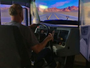 student using the truck driving simulator