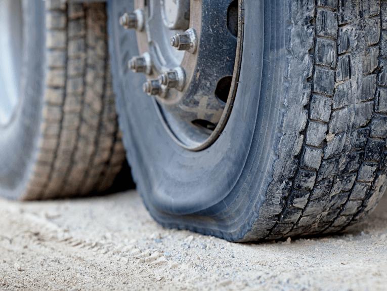Deflated Semi truck tire